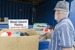 Recycling Center. Man throwing plastic waste in recycling and disposal center Royalty Free Stock Photo
