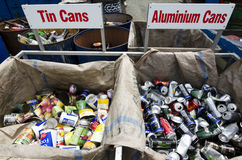 Recycling Center. Man throwing  glass waste in recycling and disposal center Stock Image