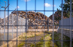 Recycling centre from behind a fence. Royalty Free Stock Photography