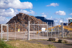 Recycling centre from behind a fence. Stock Photo