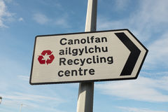 Recycling centre bilingual sign. Stock Photos