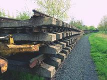 Recycling company stock. Rail platform with extracted  old rails and sleepers Royalty Free Stock Photography