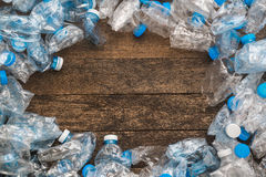 Recycling concept. The problem of ecology, environmental pollution. Background of plastic bottles transparent blue net. In the cen Stock Photo
