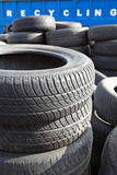 Recycling container and tires. Recycling business, container and car tires stock photo