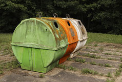 Recycling containers. Very old and dirty reycling containers Stock Photography