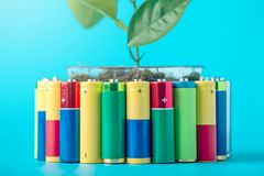 Recycling and disposal of alkaline batteries. Concept of energy friendly to the environment and ecology. Recycling and disposal of alkaline batteries. The Royalty Free Stock Photo