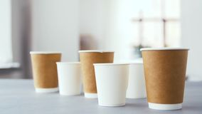 Various disposable paper cups for hot drinks