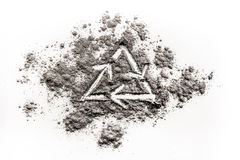 Recycling ecology icon drawing in a pile of grey ash Stock Photos