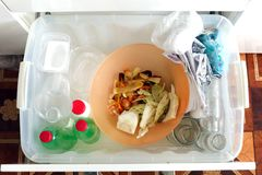 Recycling and ecology. Sorting segregating household waste paper, glass, plastic into contaner captured from above, flat lay. Sorting of garbage types. Waste stock image