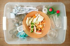 Recycling and ecology. Sorting segregating household waste paper, glass, plastic into contaner captured from above, flat lay. Trash box container for recycle stock image