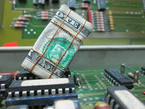 Recycling electronic boards, dollar bill. The recycling of old electronic boards is a lucrative business that generates income , also the positive impact on the stock photos