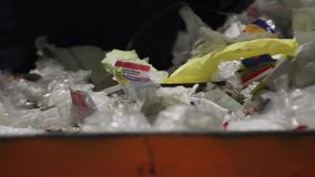 Recycling factory workers. Workers sorting garbage, waste to be processed in a recycling plant. Enviroment protection concept. Sorting paper and plastic on a stock video
