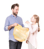 Recycling - family sorting waste - isolated on white. Recycling and ecology - father and daughter sorting segregating household waste - isolated on white Stock Images