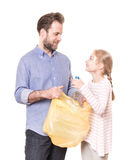 Recycling - family sorting waste - isolated on white. Recycling and ecology - father and daughter sorting segregating household waste - isolated on white Stock Photography