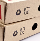 Recycling and fragile symbols. Printed on a cardboard box Stock Photography
