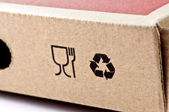 Recycling and fragile symbols. Printed on a cardboard box Royalty Free Stock Photos
