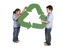 Recycling is a game. Brother and sister playing with a recycling symbol Stock Image