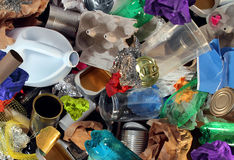Recycling Garbage. And reusable waste management as old paper glass metal and plastic household products to be reused as a concept of environmental conservation Royalty Free Stock Photo