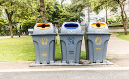 Recycling and garbage bins. In the park royalty free stock images