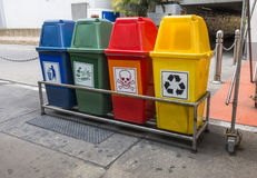 Recycling and garbage bins. Raw of recycling and garbage bins on sidewalk stock images