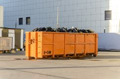 Recycling of garbage and waste, a large orange container for waste of a certain category a. Recycling of garbage and waste, a large orange container for waste of royalty free stock photo