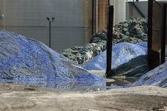 Recycling Glass. Mounds of ground blue glass in a recycling yard Stock Photo