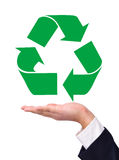Recycling on a hand Royalty Free Stock Photography