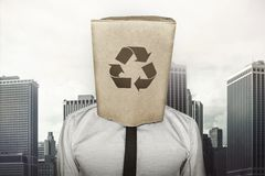 Recycling icon on paper bag what businessman is Stock Image