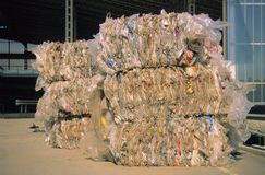 Recycling industry. Piles of plastic bags and containers ready to be recycled stock photography