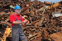 Recycling industry, heap of old metal and worker Stock Photography