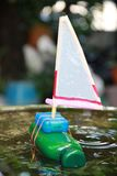 Recycling kids toy. Shampoo Sailboat Bottle.Handmade sailboat made form empty shampoo bottle.Piece of reuse things to hold the stirrer that make from recycled royalty free stock images