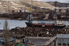 Recycling, loading scrap metal in the ship royalty free stock photo