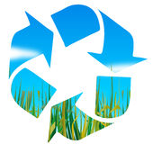 Recycling logo. With grass and sky Stock Photos