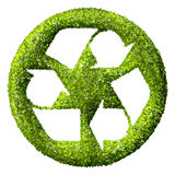 Recycling logo symbol from the green grass. Stock Images