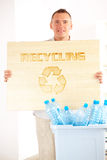 Recycling Man With Board Stock Photography
