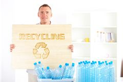 Recycling Man With Board Stock Photos