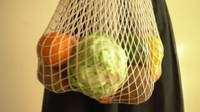 Recycling mesh string bag full of vegetables and fruits, eco frindly no plastic concept 4k. Recycling mesh string bag full of vegetables and fruits, eco frindly stock video footage