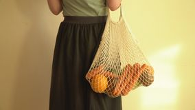 Recycling mesh string bag full of vegetables and fruits, eco frindly no plastic concept 4k. Recycling mesh string bag full of vegetables and fruits, eco frindly stock video