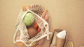 Recycling mesh string bag full of vegetables and fruits, eco frindly no plastic concept 4k. Recycling mesh string bag full of vegetables and fruits, eco frindly stock footage