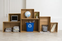 Recycling objects. A recycling bin and various objects Stock Photo