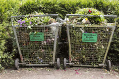 Recycling: organic waste. Crates with organic waste on a public cemetery (signs in German for compost Royalty Free Stock Photo