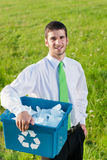 Recycling paper box businessman in sunny meadow Stock Photo