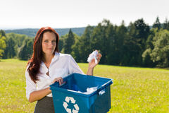 Recycling paper box businesswoman in sunny meadow Stock Photos
