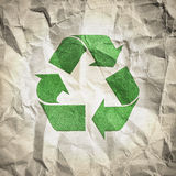 Recycling paper. Crumpled recycled paper texture with recycle logo Royalty Free Stock Image