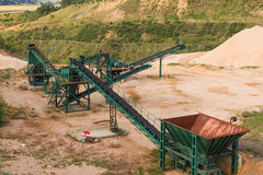 Recycling Plant in Gravel Pit. Recycling plant material Gravera with ribbons distribution and gravel piles of gravel or sand for the construction industry Royalty Free Stock Images