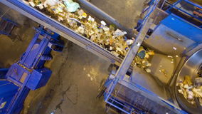 Recycling plant. Wide angle shot of a conveyor sorting garbage. Conveyor at a recycling plant. Wide angle shot. 4K stock footage