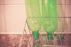 Recycling plastic bottles at home. Plastic bottles drying at home in kitchen prior to being recycled Royalty Free Stock Images