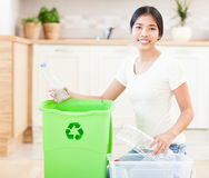 Recycling Plastic Bottles. Young Asian women with a crate full of plastic bottles for recycling Royalty Free Stock Images