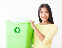 Recycling Plastic Bottles. Young Asian women with a crate full of plastic bottles for recycling Stock Photography