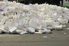 Recycling polystyrine styrofoam. The polystyrine foam boxes used to store fresh fishes from the catch of the day being kept at a warehouse for recycling purpose Royalty Free Stock Photo